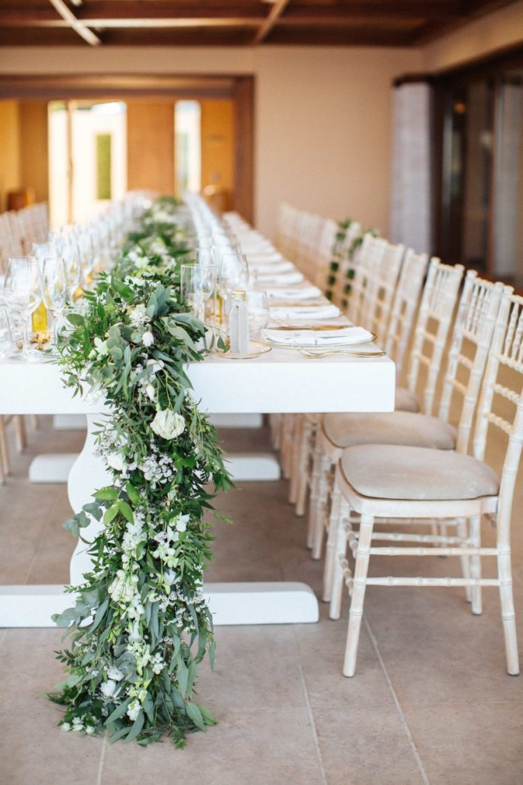 The wedding table runners were lush and extra long to add chic to the reception