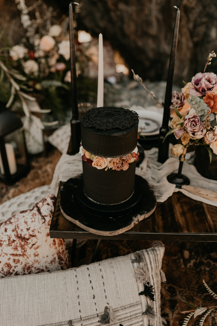 The wedding cake was a black one, made up of two parts and with lush bright flowers in between