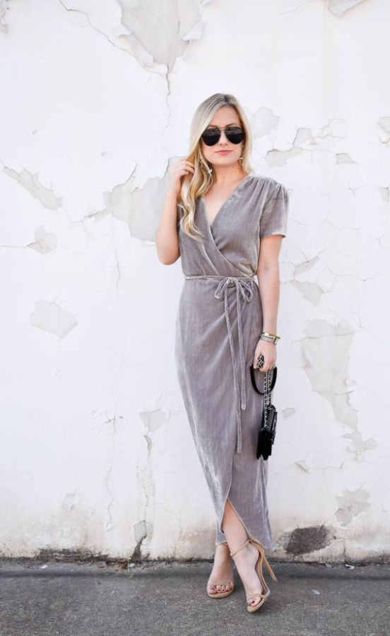 a grey velvet wrap maxi dress with short sleeves, a black bag and nude heels for a fall wedding
