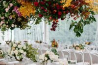 14 a super lush and super bright floral installation over the reception tables will make a gorgeous statement