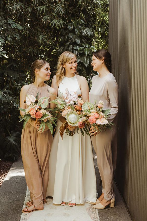 mismatching modern neutral bridesmaid dresses will complement any appearance types and complexions