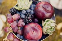 15 a beautiful edible centerpiece with grapes, plums, blackberries, blueberries and succulents in a bowl