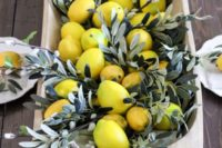 16 a wooden dough bowl with pussy willow and lemons for a Tuscany-inspired wedding