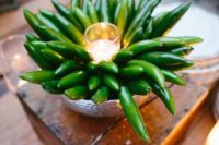 17 an unusual and bold wedding centerpiece with a hammered bowl, peepers and a candle in a candle holder