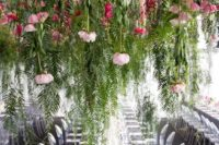 17 keep your reception clutter-free creating such lush greenery and pink bloom installations over the tables