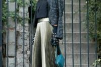 18 a black crop top, a metallic high waisted pleated midi skirt, a teal bag, black heels and a studded moto jacket
