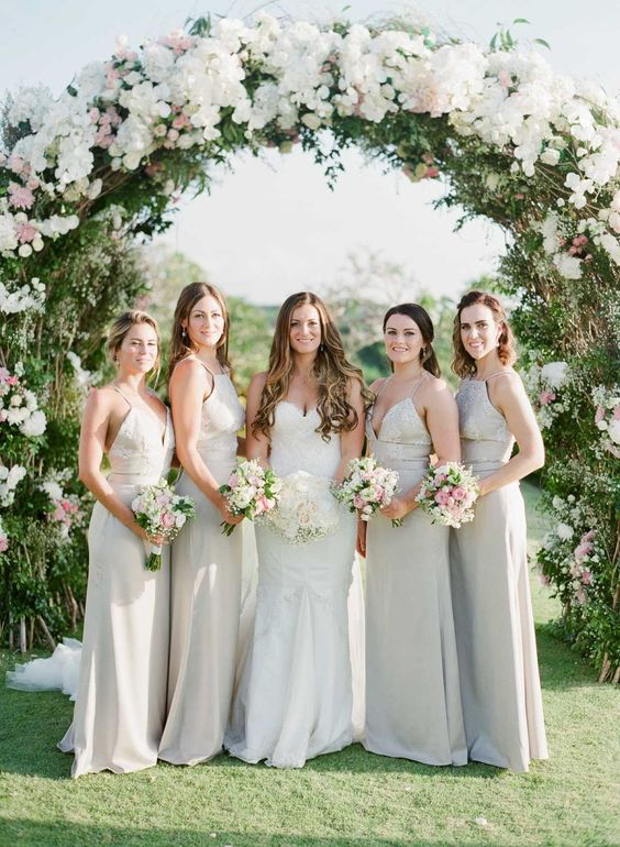 neutral mismatching maxi bridesmaid dresses will help the gals feel more comfortable on a hot day