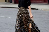 19 a black oversized sweater, a blakc and gold geometric midi skirt, black lace up shoes and a camel bag