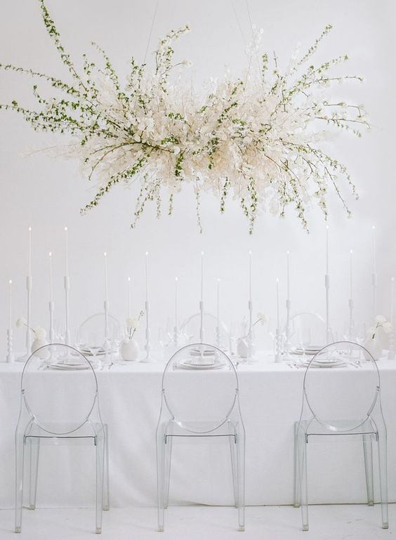 an ethereal white bloom and greenery wedding installation instead of a usual wedding centerpiece