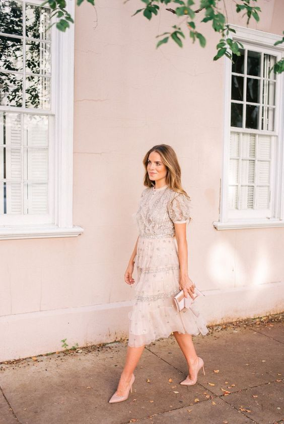 a girlish creamy dress with short puff sleeves, embellishments, embroidery, a blush cltuch and shoes