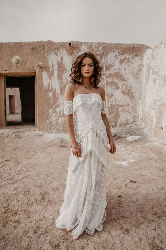 a beautiful sheath wedding gown featuring long fringe and lace arm band sleeves