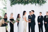 21 an overhead greenery and white bloom wedding installation as a wedding ceremony backdrop