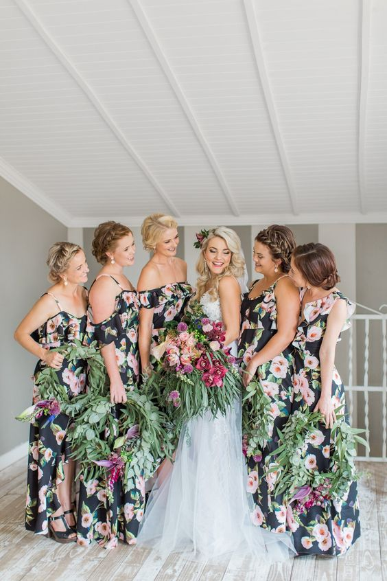 dark floral cold shoulder maxi bridesmaid dresses with ruffles are a chic and non-typical idea for a tropical wedding