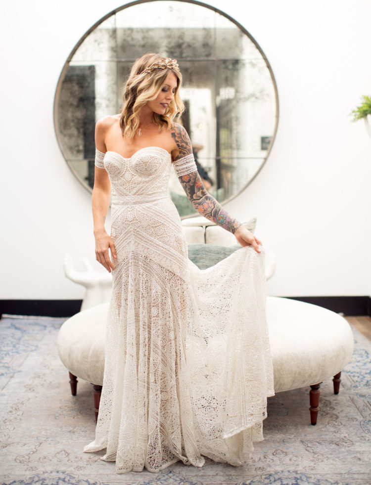 a stunning boho lace sheath wedding dress with a sweetheart neckline and matching arm band sleeves