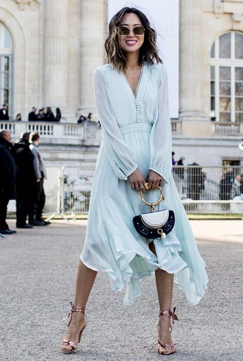 an airy aqua-colored midi dress with an asymmetrical skirt, long sleeves and buttons, a catchy bag and copper shoes