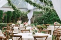 23 lush greenery garlands over the reception space are a luxurious and very fresh idea to feel like outdoors
