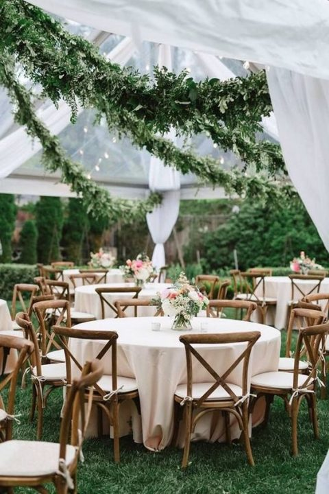 lush greenery garlands over the reception space are a luxurious and very fresh idea to feel like outdoors