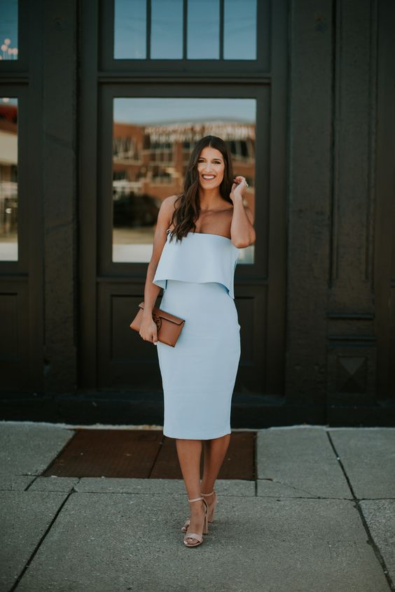 a powder blue strapless midi dress with a layered bodice, nude heels and a brown clutch