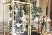 26 floral and greenery installations in gilded frames with wedding signage is a modern adn fresh idea of a seating chart