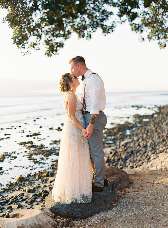 This romantic Hawaii wedding was inspired by Maui sunsets and was perfectly polished by the bride, who is a wedding planner
