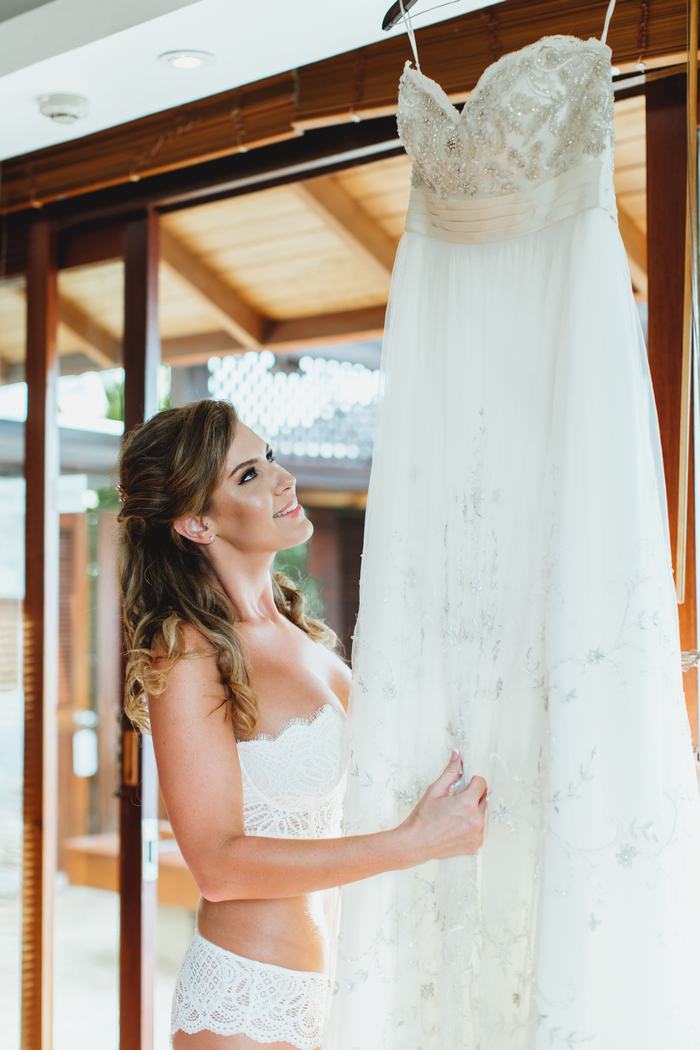The bride was wearing a strapless embellished wedding gown with an A-line silhouette