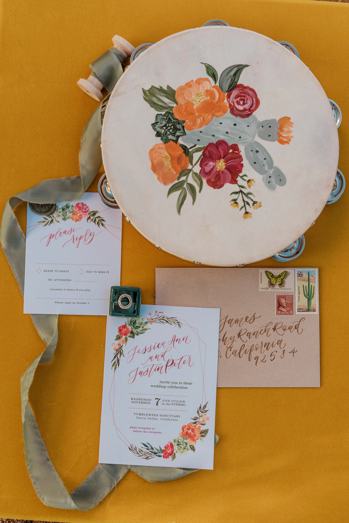 The wedding invitation suite was done with bright watercolor blooms, calligraphy and cacti