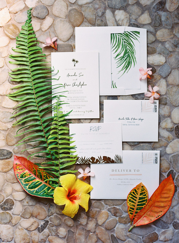 The wedding invitation suite was done with tropical elegance and calligraphy