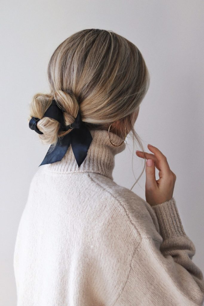 an elegant low bun interwoven with a black ribbon is a very chic idea, suitable for many bridal styles