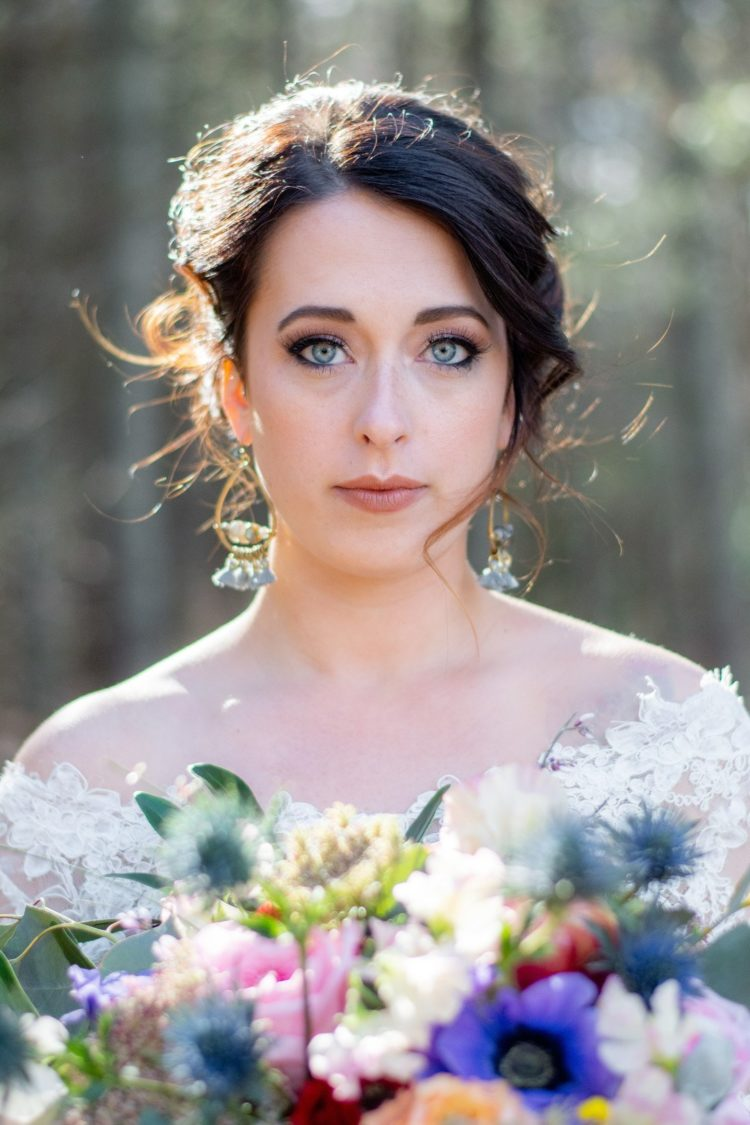 The bride was rocking blue statement earrings with tassels that matched her eyes