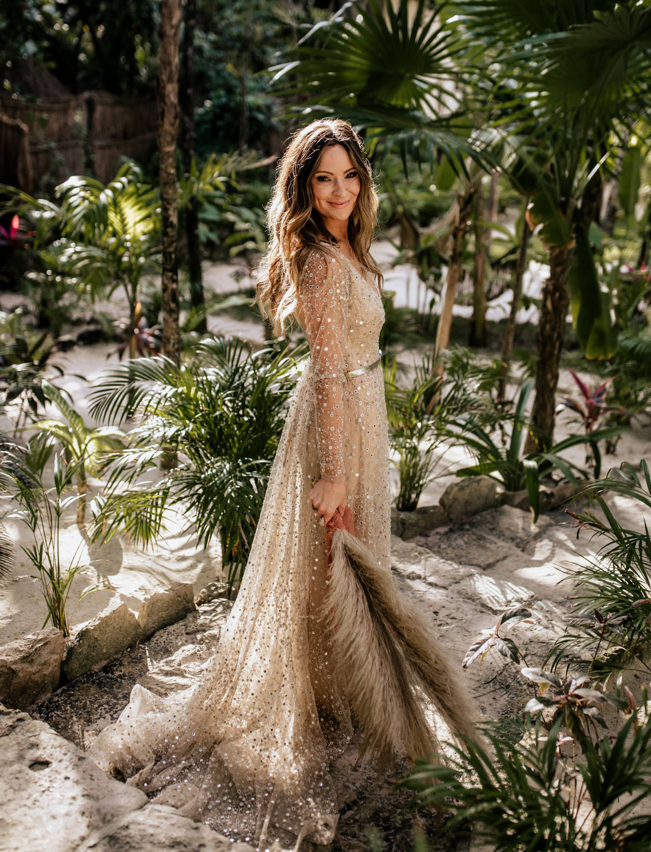 The bride was wearing a sparkling Nala wedding gown and was carrying a wedding bouquet of pampas grass