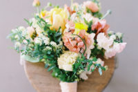 03 The bright wedding bouquet was inspired by the islands and was done in red, blush and yellow tones