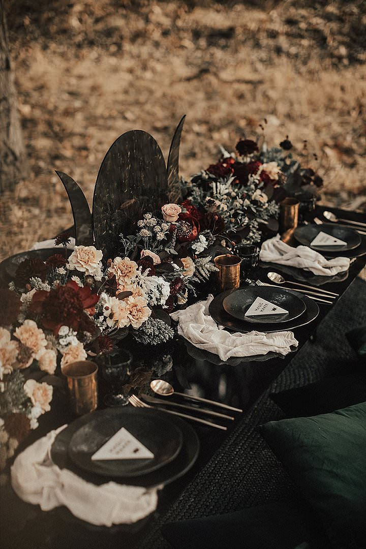 The tablescape was a black one, with peahcy and burgundy blooms, black plates and chargers, gold mugs and a moon sign