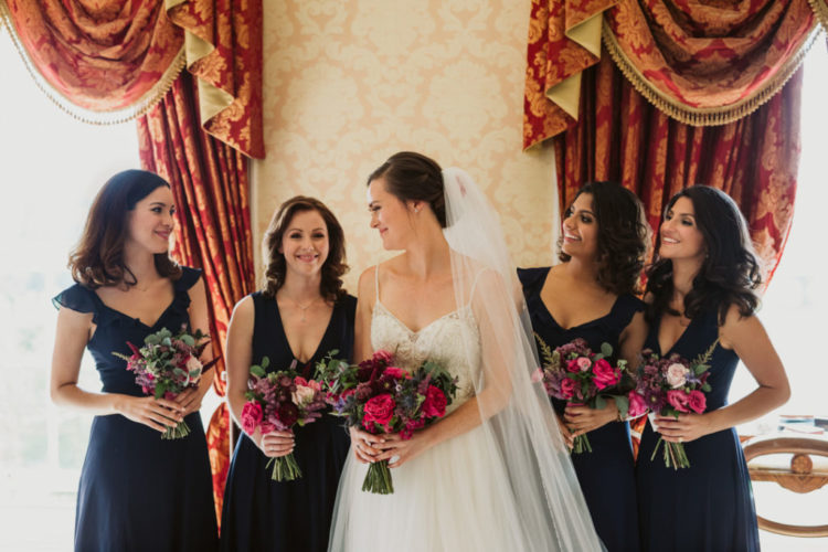 The bouquets were bright and bold, with textural greenery and added color to the wedding