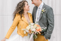 04 The bride covered up with a marigold leather jacket, the groom was wearing a grey jacket with a bee print, marigold pants and a floral tie
