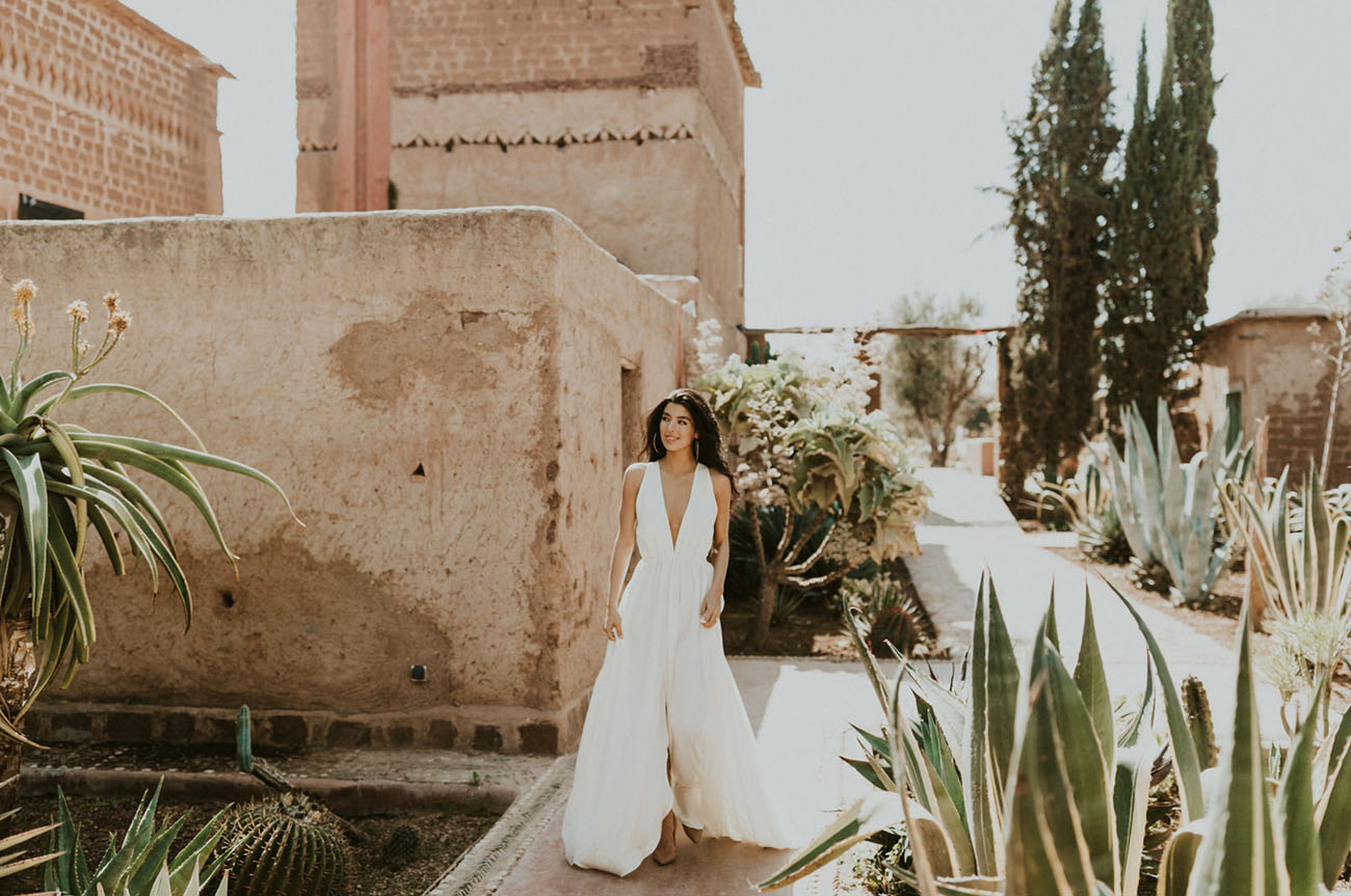 The bride was wearing a modern wedding dress with a plunging neckline and neutral shoes