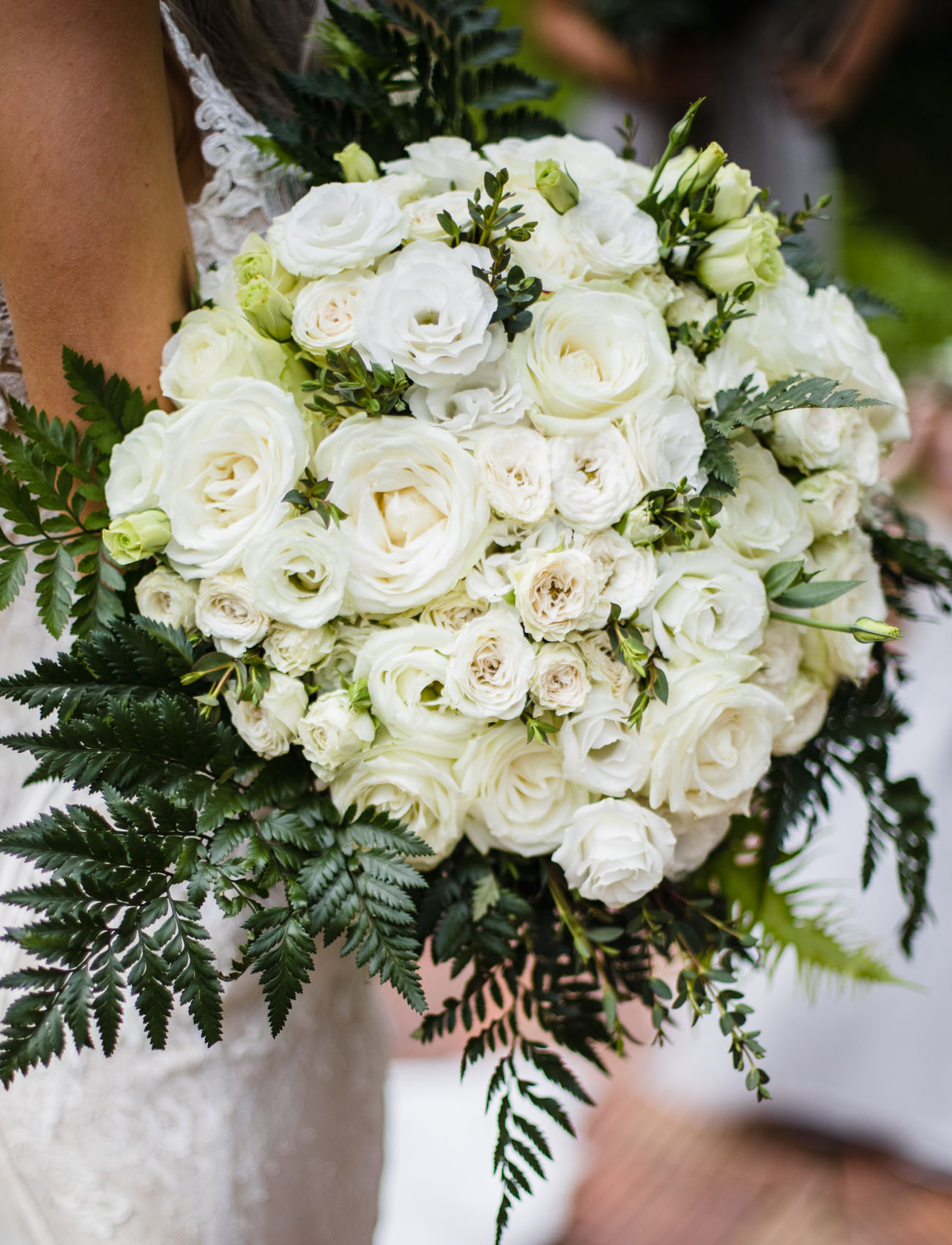 The bouquets were white and styled with greenery