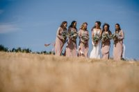 The bridesmaids were wearing dusty pink maxi dresses with lace bodices and plain skirts