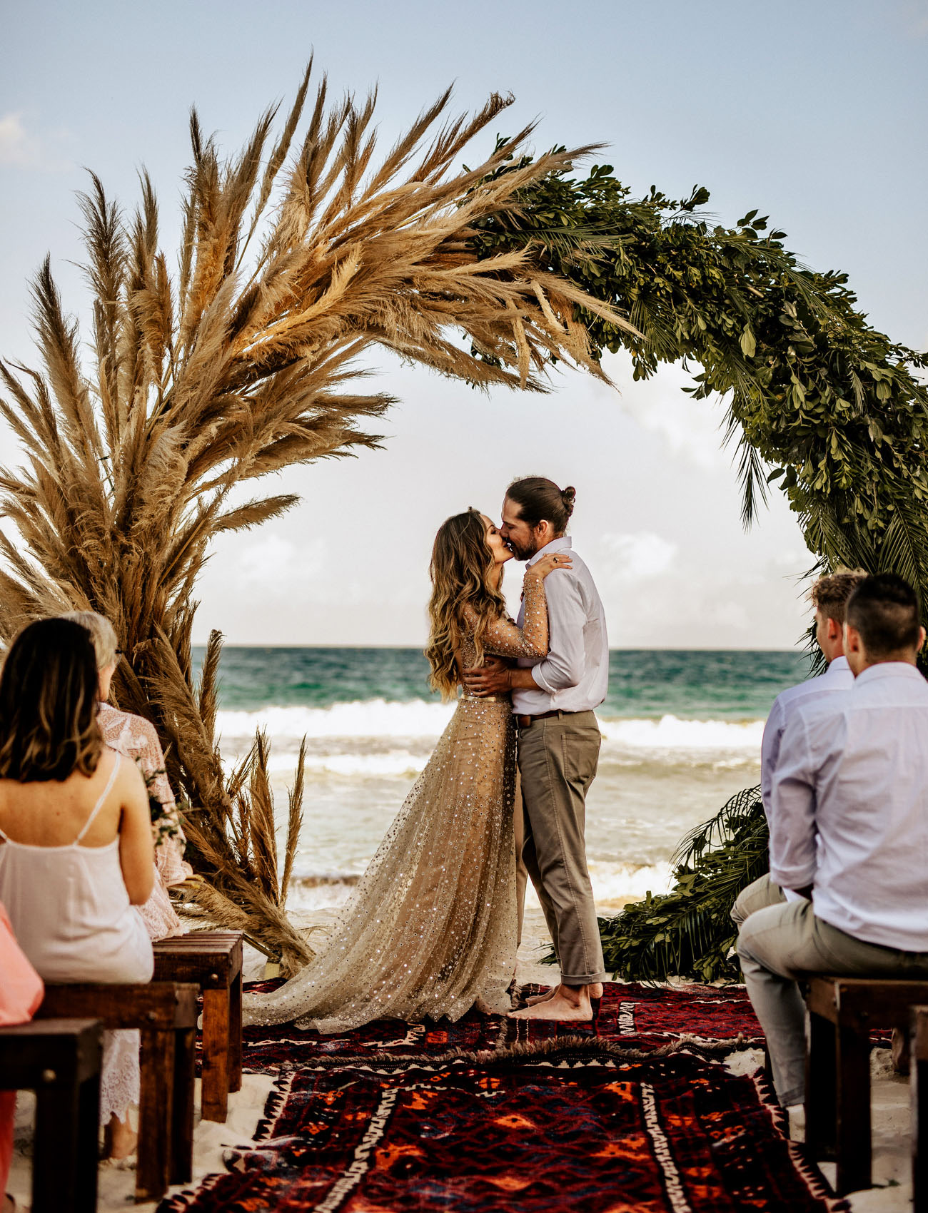 The ocean wedding backdrop was amazing for these nuptials