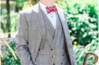 05 a light grey windowpane three-piece suit, a white shirt, a red striped tie and a black hat plus a chain