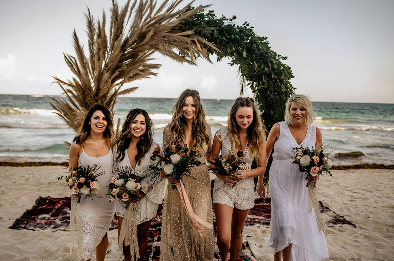 The bridesmaids were wearing mismatching white gowns