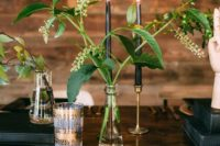 06 clear vases with greenery and black candles create a chic look with a minimalist feel – nothing unnecessary here