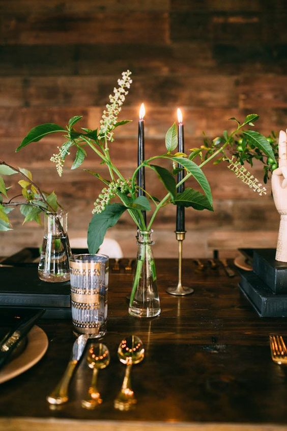 clear vases with greenery and black candles create a chic look with a minimalist feel   nothing unnecessary here