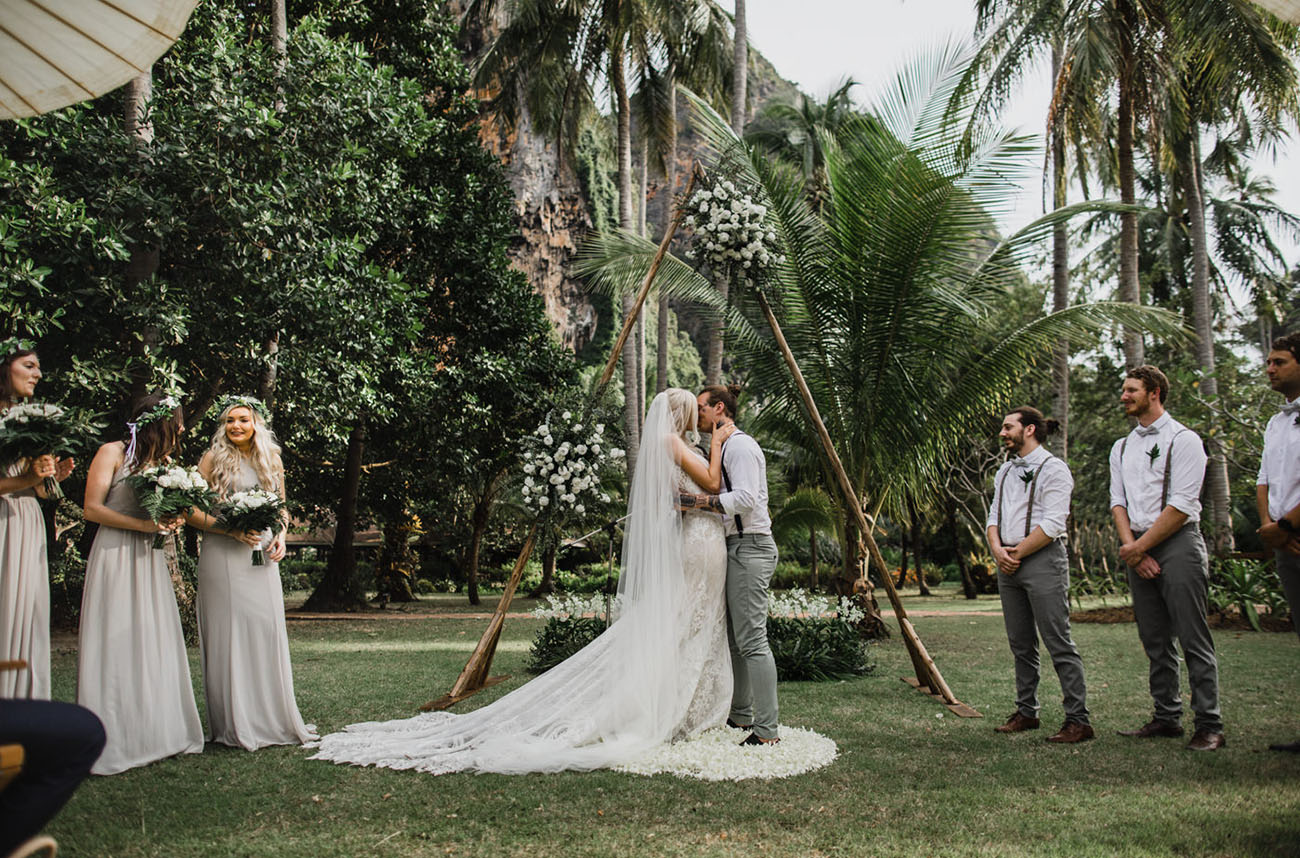 The bridesmaids were wearing off white maxi dresses and the groomsmen were rocking the same as the groom