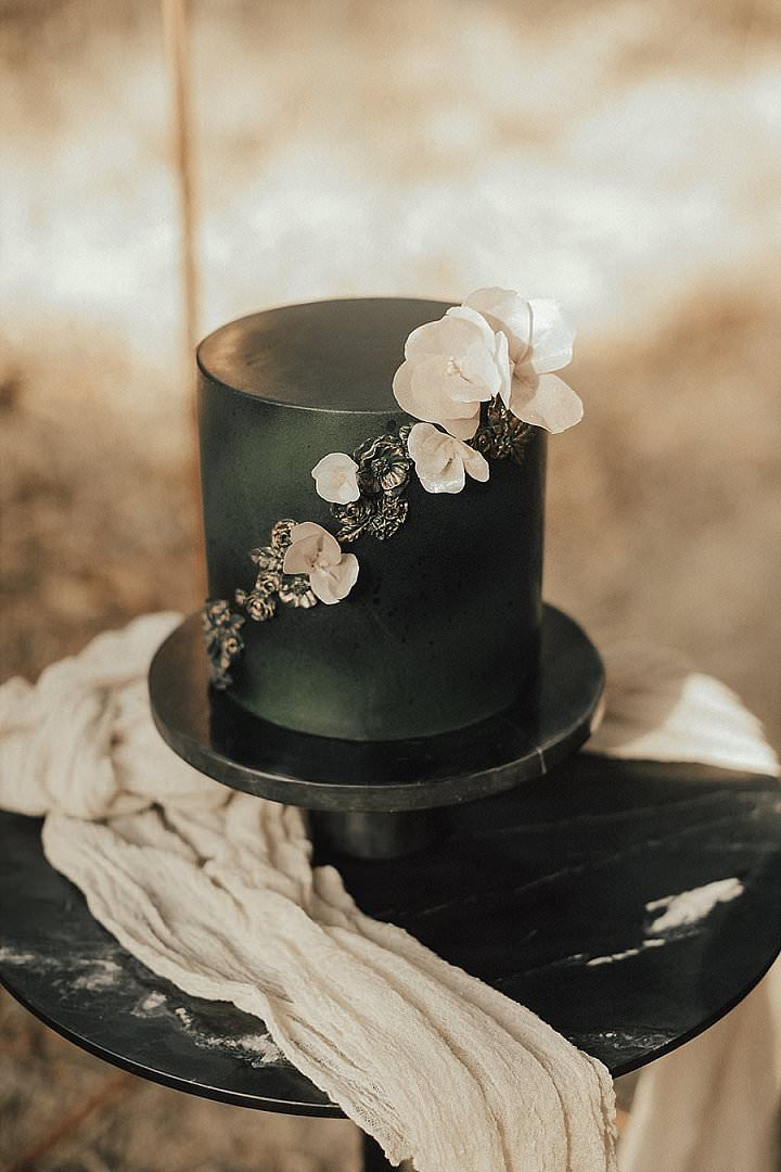 a stylish black wedding cake