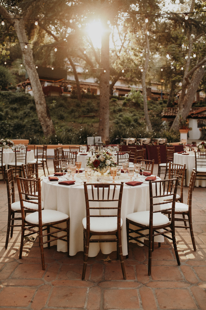 The wedding venue was done with lights, elegant tablescapes and chic blooms