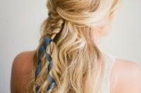07 a wavy half updo with a messy top and a brid accented with a navy ribbon for that 'something blue' touch