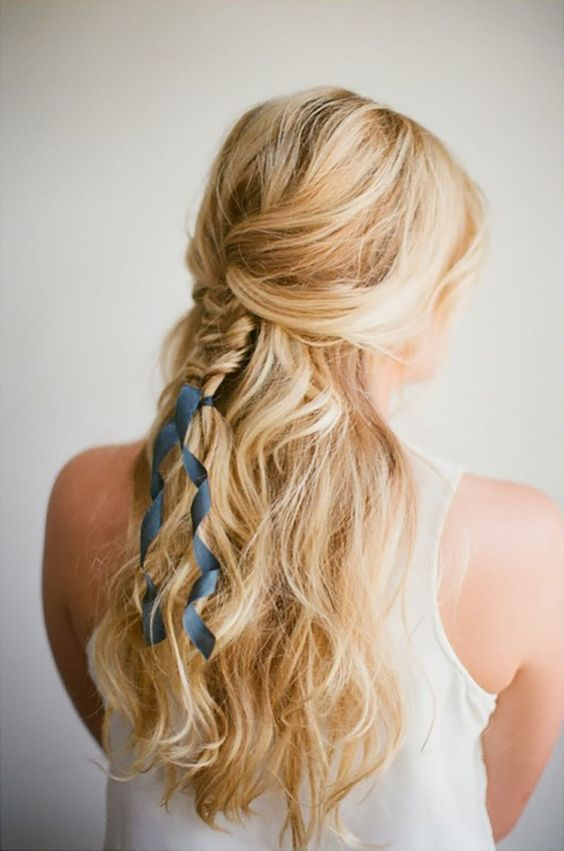 a wavy half updo with a messy top and a brid accented with a navy ribbon for that 'something blue' touch