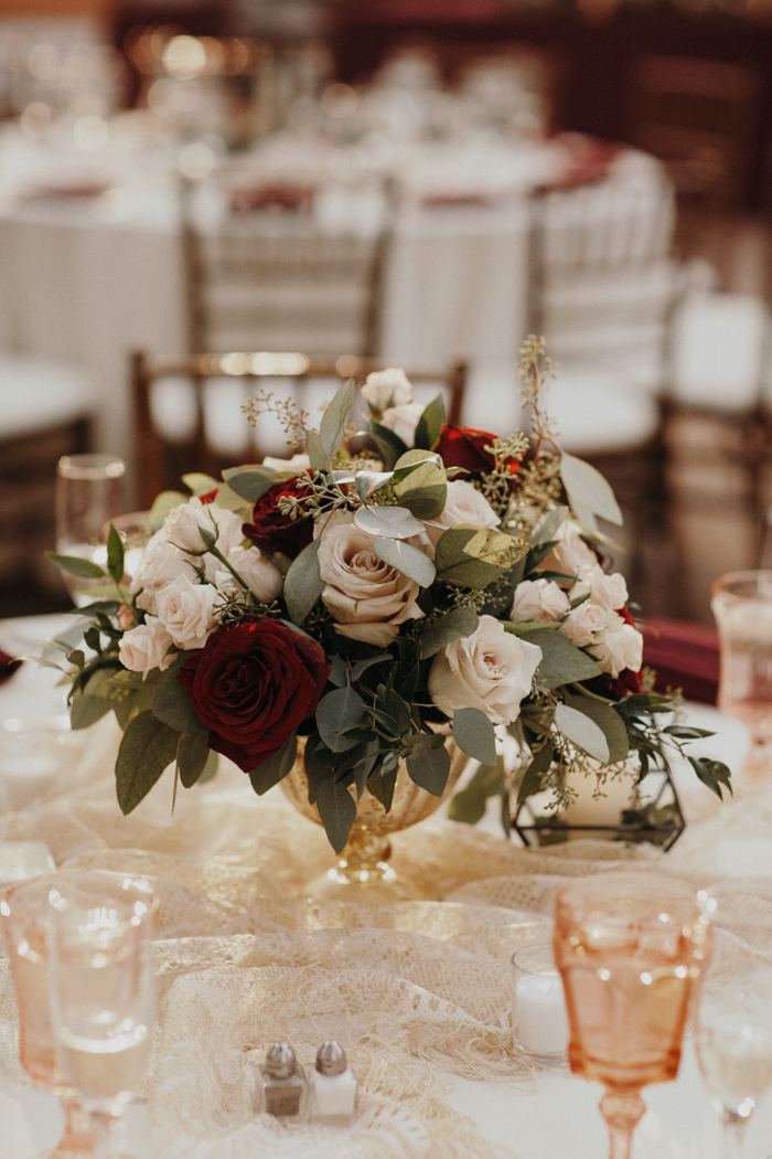 The blooms were elegant, with neutral, burgundy flowers and greenery in a gold vase