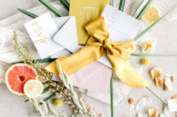 08 The wedding invitation suite was done with modern printing, marigold ribbons and an envelope