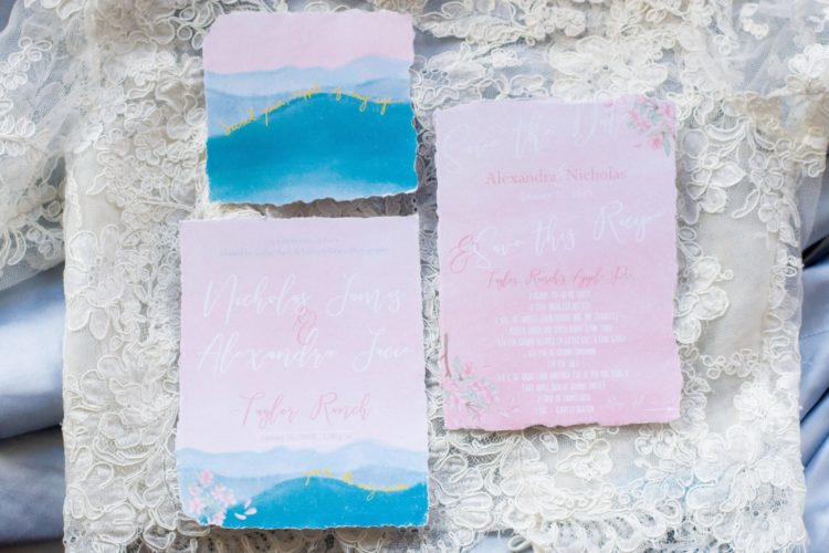 The wedding stationary was done with watercolors and in pink and blue
